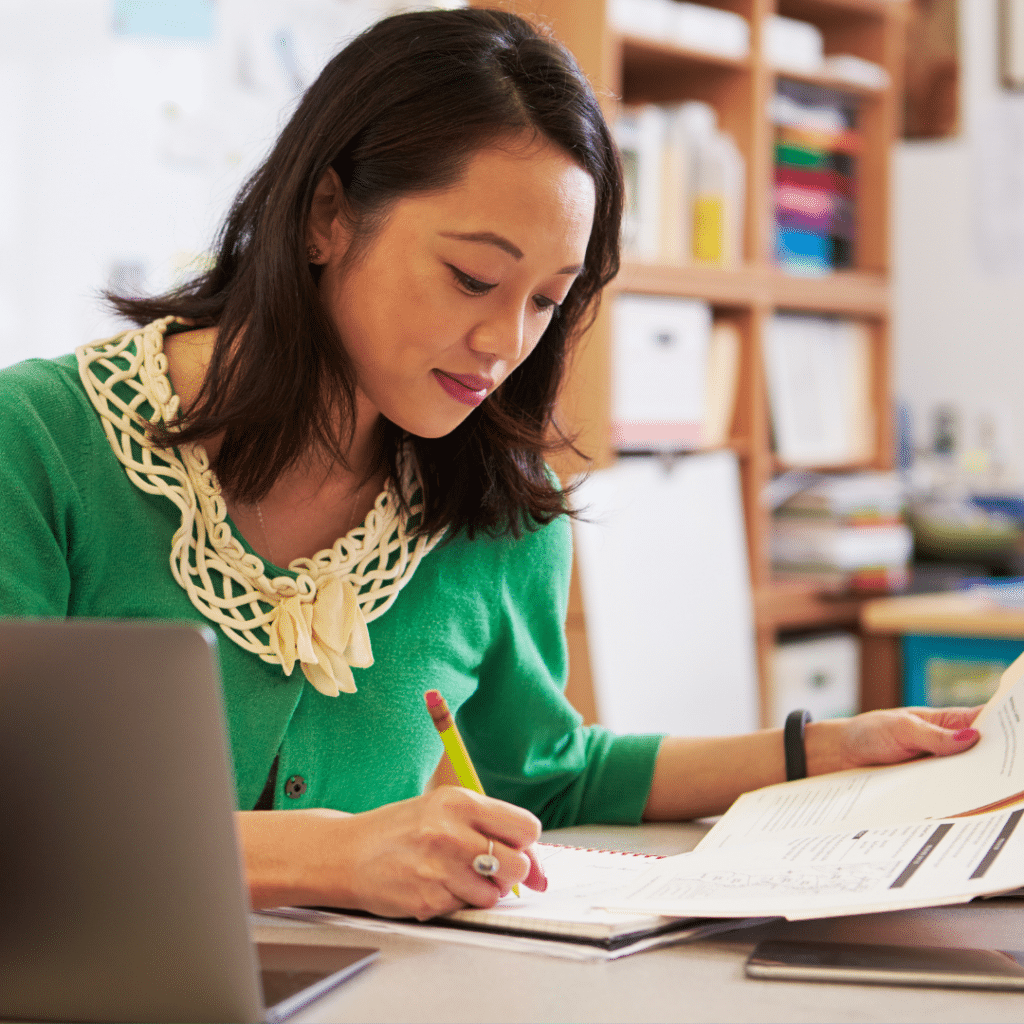 Teacher working at her desk planning classroom time management