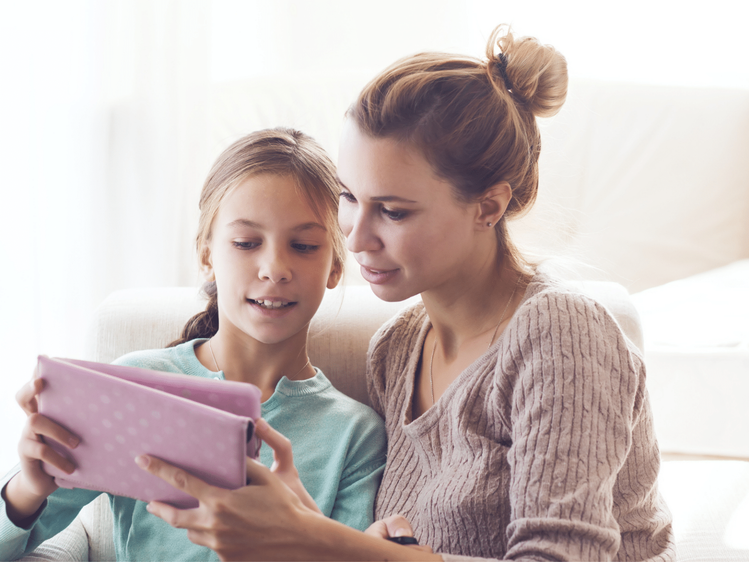 Mother and Daughter sharing ipad